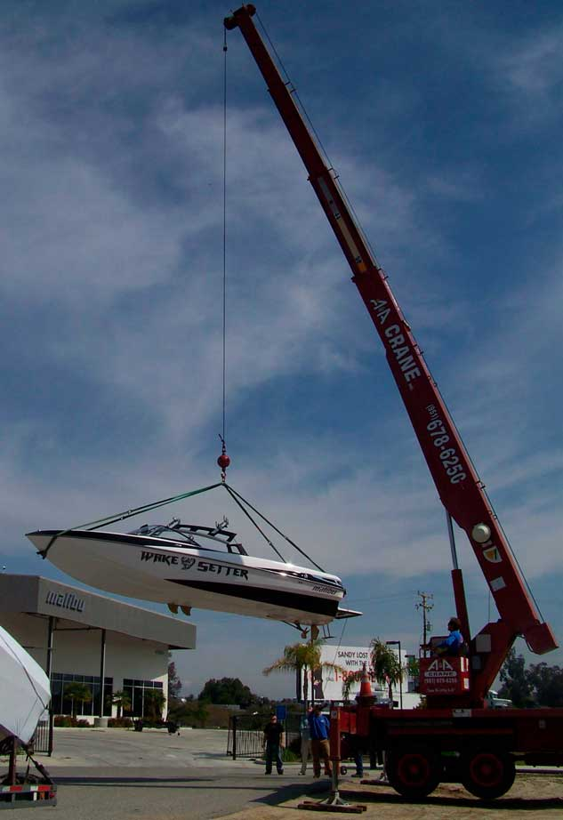 Our crane lifting a boat.