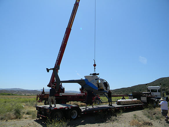 A picture of our crane lifting a helicopter that crashed.