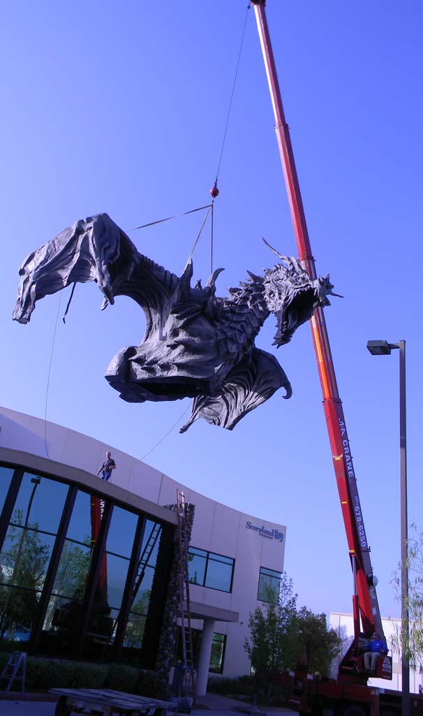 A second picture of our crane lifting a special effects foam dragon.