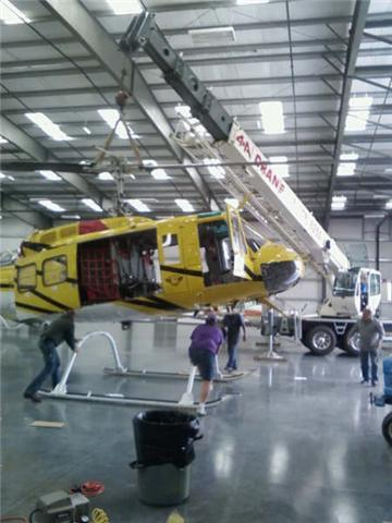 Our crane lifting a firefighting helicopter
